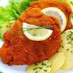 120/160g Viedenský bravčový rezeň,(zemiaky podľa dennej ponuky)