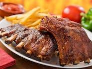 Coaste porc la grătar, cartofi prăjiți, murături asortate