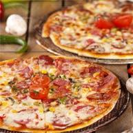 Przy zamówieniu dwóch dużych pizz 15% zniżki + sosy gratis!
